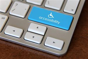 The corner of a laptop with accessibility key