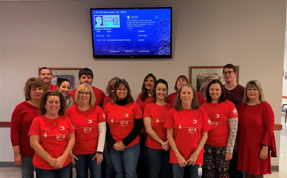 LIU staff wear red to support students experiencing homelessness