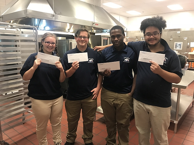 LIU Transition students showing off their first paychecks.